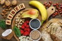 Collection of different fruits and vegetables rich in fiber to help with constipation