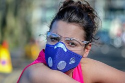 woman with glasses wearing a face mask to protect against asthma and allergies