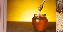 a jar full of honey on a table