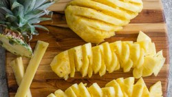 table filled with sliced pineapples