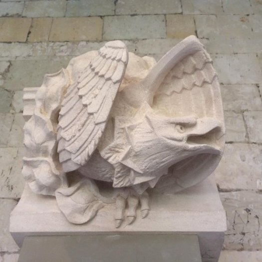 Photo showing a carving of a crouching eagle with wings half raised
