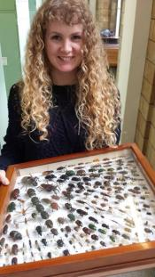 Photo showing Katy holding the drawer in front of her, displaying an array of different Coleoptera