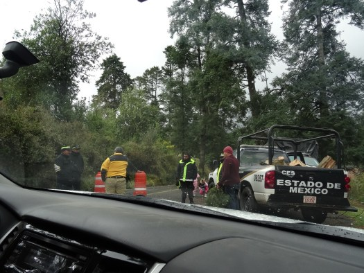 Photo showing Mexican police officers manning a barricade across the road