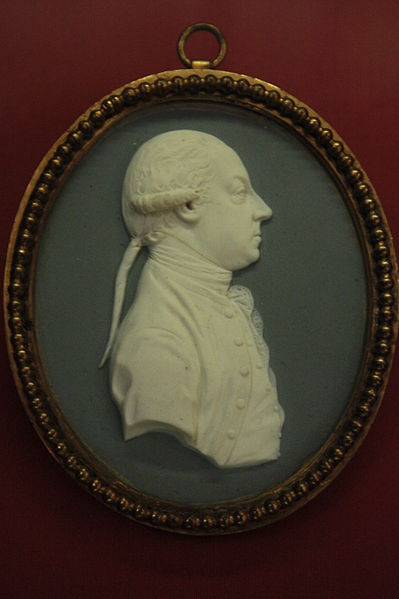 Photo of an ivory miniature portrait of Thomas Pennant from the right side, within an oval shaped medallion.