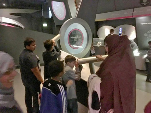 Young visitors from CARAS exploring the telescopes in Earth Sciences