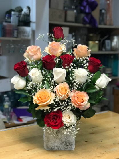 LVRE035- White, red, mango and peach roses with baby breathe.