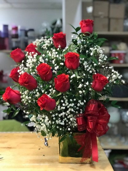 LVRE030- Red roses and baby breath.