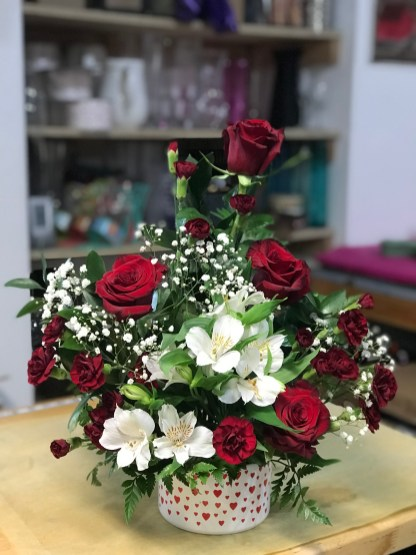 LVRE020-Red roses,red mini carnations and white astromelias on a ceramic vase of small red heartsSpecial: $48.00