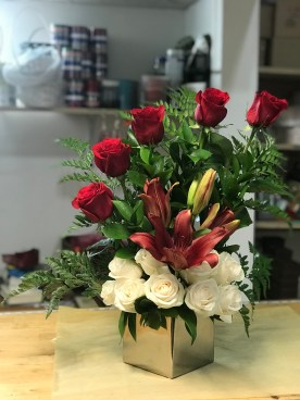LVRE008-Great combination red roses, red lilies and white roses on an square silver vase$85.00