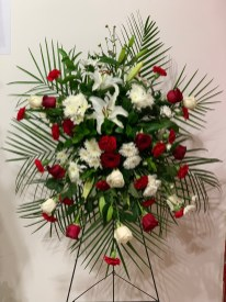 FNR016 $280.00 Spray arrangement with red and white flowers