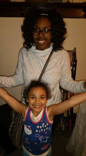 With my sister wearing a Bantu Knot-Out