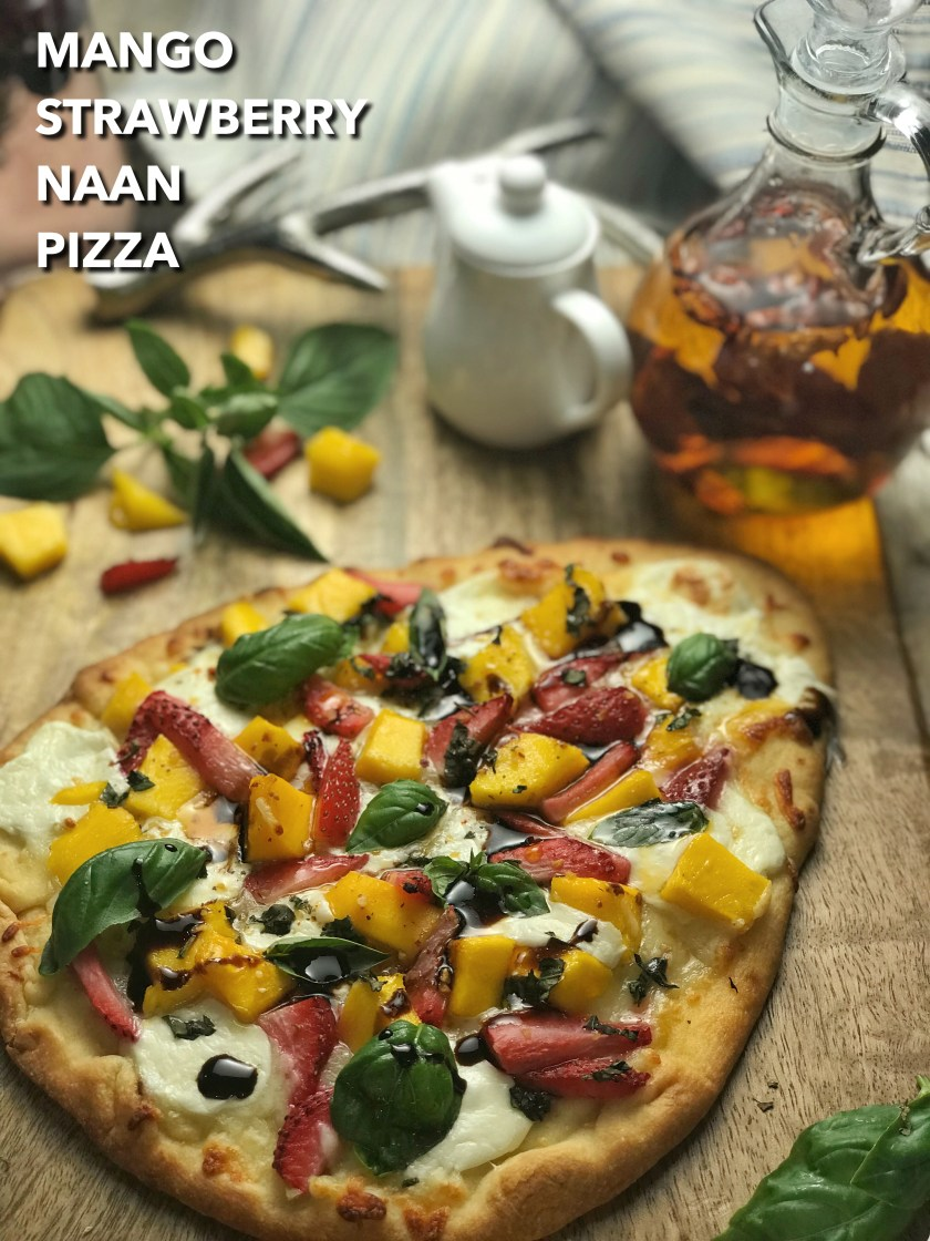 Mango Strawberry Naan Pizza - delicately crispy exterior, soft chewy insides, glamorously golden brown, and zero percent greasy. This mango strawberry pizza with fresh mozzarella and parmesan is the most gorgeous, juicy FRUIT PIZZA ever!!