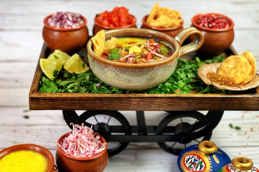 This Muradabadi Dal Chaat, a famous Indian street food, features healthy protein packed yellow moong dal lentils topped with a variety of fresh vegetables and spices. It's a decadent, yet delightfully simple dish that is sure to warm you up as the weather starts to become cooler.