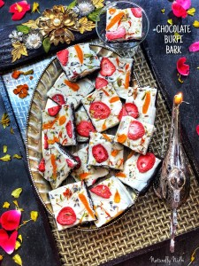 This Chocolate Burfi Peda Bark is a lovely dessert made with layers of chocolate burfi (peda) and white chocolate that's topped off with dried fruits, flowers, and spices! There's strawberries for acidity, lavender buds for a great aroma, and chopped pistachio for an added saltiness.