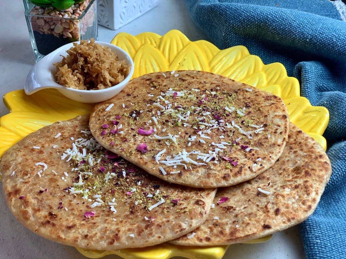 Coconut Jaggery Paratha (Nariyal Aur Gur Ka Paratha) - A quick fix for those quarantine sweet tooth pangs, this sweet coconut-jaggery stuffed Indian flatbread is flavored with cardamom, saffron and rosewater. It's a perfect way to enjoy a traditional sweet without needing to indulge!