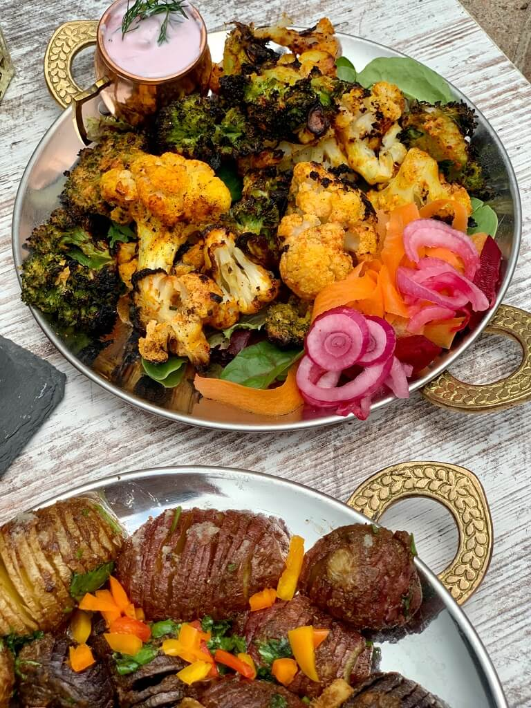 Spiced with za'atar and smoked paprika, this Mediterranean Tandoori Cauliflower Broccoli, roasted to golden brown is the perfect fusion of Indian and Mediterranean flavors. Pair it with some homemade pita bread, hasselback potatoes, and dal makhani for a delicious meal!