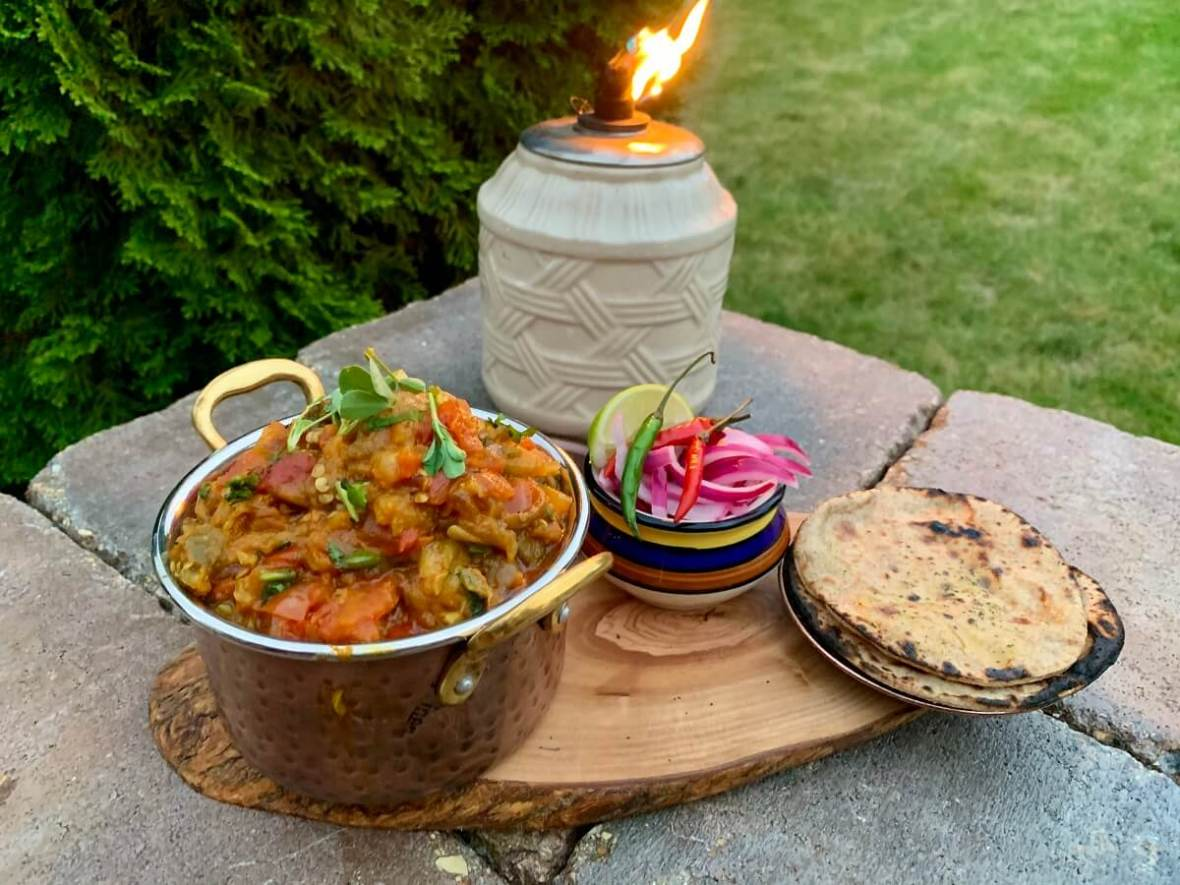 Dhungare Baingan Bharta (Smoked Eggplant Curry) – with fire roasted eggplant, aromatic spices, and some tangy yogurt is a popular Punjabi dish enjoyed all over India! Serve it with some naan or roti and savor the fiery smokiness of the grill!