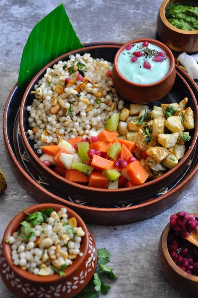 Coconut Sabudana bowl with lightly seasoned roasted potatoes, cilantro mint raita and a side of fresh fruits is a perfect combination to try this Navaratri. This nutritious meal is a popular fasting choice when you don't want to eat grains like rice and flour.