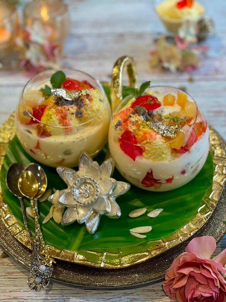 Rasmalai Falooda - a fusion of two beloved Indian desserts with fruits and jelly. Garnished with some edible 24k gold, it's the perfect way to elevate the classic flavors that are enjoyed all over India!