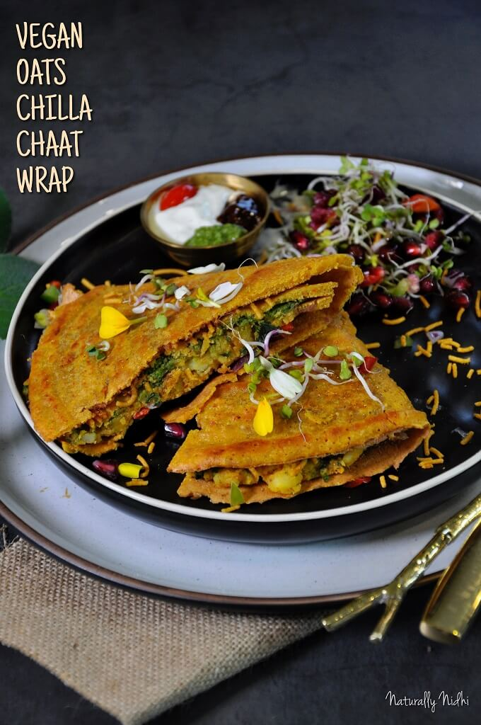 Vegan Oats Chilla Chaat Wrap - an Indian twist on the popular TikTok tortilla trend! Featuring a oats chilla, spicy aloo masala, chutneys, and veggies, this vegan wrap is a perfect crunchy, chatpata snack!