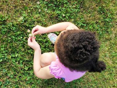 Keeping Family Time Simple This Summer - Toddler Picking Flowers| Naturally Stellar