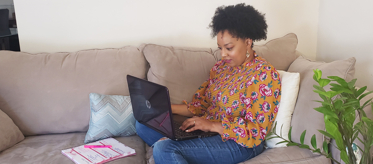 Woman working from home on the couch   Naturally Stellar