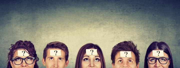 Five confused people, each question mark sticker on their foreheads.
