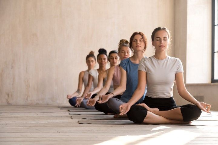 A group of young women practicing yoga together.