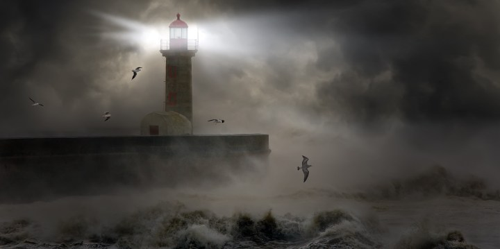 A lighthouse shining through a storm symbolizes the promise of hope.