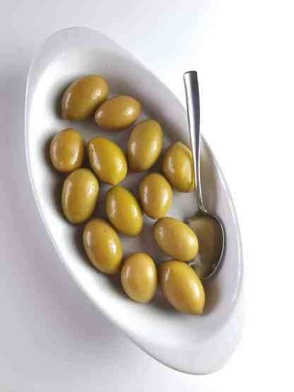 Дамаскино Зелені оливки з кісточкою морській солі ПЕТ-пакетик 560г калибр 101 -110 Mammoth