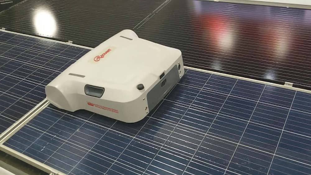 A Radiant solar panel cleaning robot on top of a solar panel.