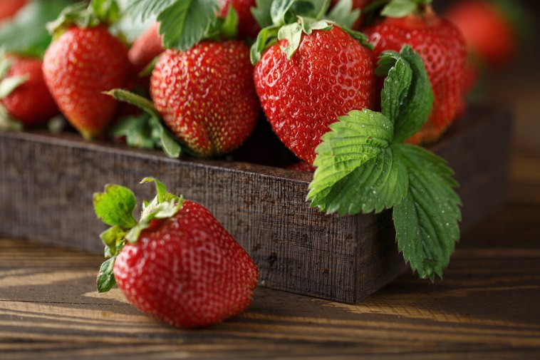 Fresh Juicy Strawberries With Leaves.