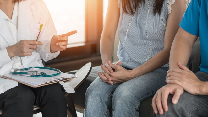 Patient Couple talking to doctor