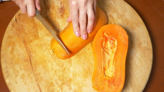 Exotic Fruits On The Table. Womens Hands Prepare Papaya For A Cu
