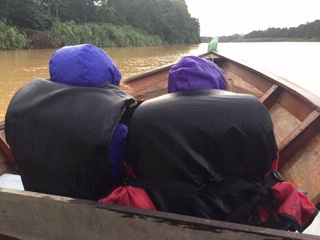 It rained during part of our riverboat cruise. We were in a longboat.