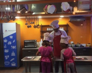 Cooking tasty treats. Kidzania, Mumbai, Marahashtra, India