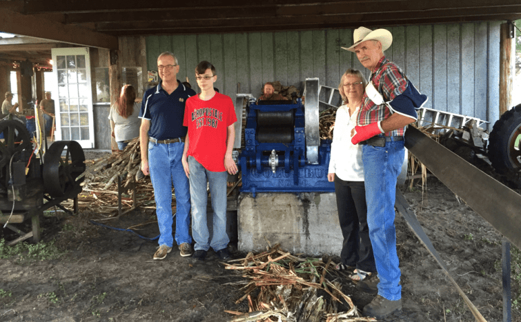 The Petter family with Steve Melton and the Columbus No. 90 Sugar Cane Mill that was restored.