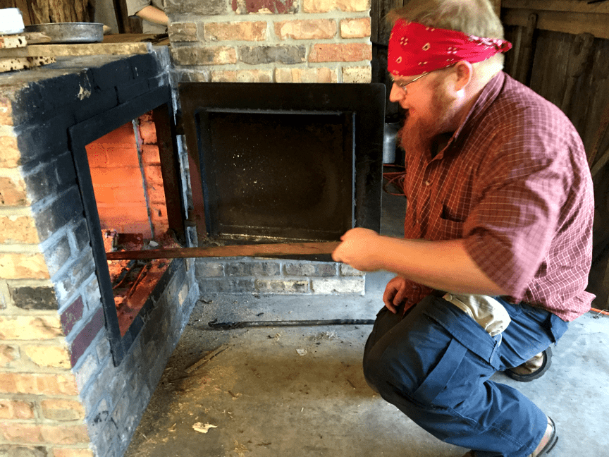 Drew builds the fire with Pine Lighterwood and Oak.