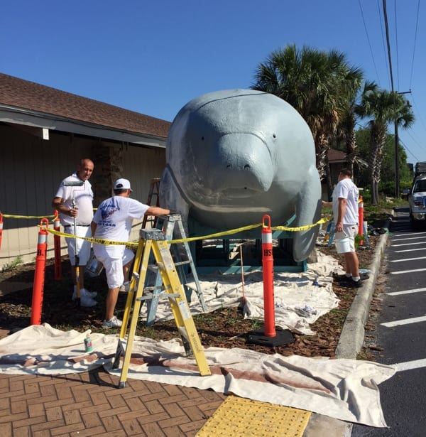 Mike Steve, Charlie Thrasher and another worker from Bud Sasada Painting refurbishing Bubbles the Manatee