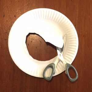 Cutting out centre of paper plate