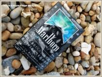 Flotsam packet of cigarettes washed ashore at Ringstead Bay