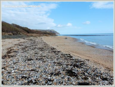 View looking east over the remaining shingle bank at the western end of Ringstead Bay.