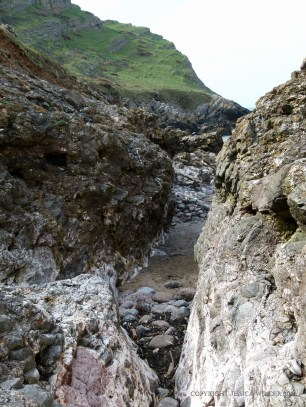 View looking through the narrow rock gully to Mewslade beach