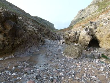 View looking from Mewslade Bay to the narrow fault gully entrance