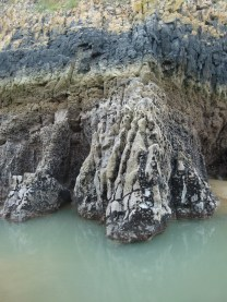 Tidal pool at the base of Carboniferous Limestone cliffs