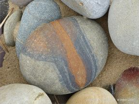 Beach stone with iron on a Gower peninsula beach in South Wales