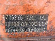 Detail of an orange flotsam fishing crate washed ashore