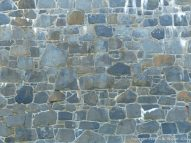 Detail of the sea wall of local stone at the southern end of Rocquaine Bay in Guernsey