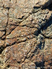 Close-up of rock on the beaach at Rocquaine Bay in Guernsey