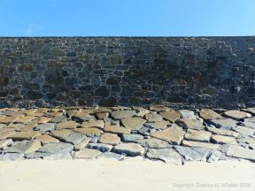 Stone sea wall at Rocquaine Bay